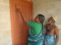 Rafeek painting the door.jpg